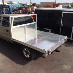 Custom low profile aluminum flatbed for Four Wheel Campers Hawk model on Chevy 2500HD