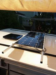 Flexible solar panel mounted to the roof